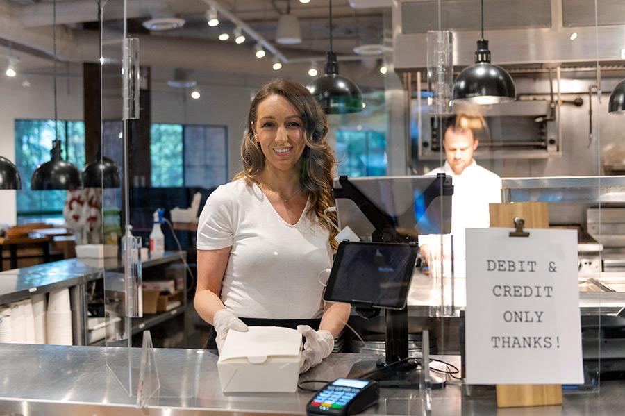 An employee safe behind glass barriers