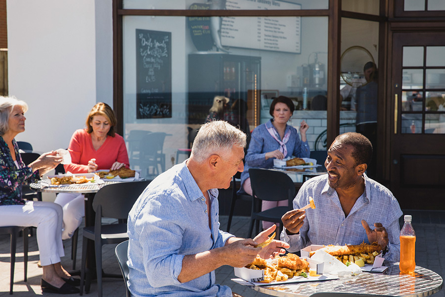 Baby Boomer consumers eating at a restaurant